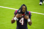 Houston Texans quarterback Deshaun Watson walks off the field before an NFL football game against the Tennessee Titans Sunday, Jan. 3, 2021, in Houston. Star quarterback Deshaun Watson has requested a trade from the Houston Texans, a person familiar with the move told The Associated Press. The person spoke to the AP on the condition of anonymity Thursday, Jan. 28, 2021, because they weren't authorized to discuss the request publicly. (AP Photo/Eric Christian Smith)