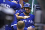 Toronto Blue Jays' Rowdy Tellez is welcomed to the dugout after hitting a home run in the sixth inning of a baseball game against the Boston Red Sox, Sunday, Sept. 6, 2020, in Boston. (AP Photo/Steven Senne)
