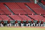 Baltimore Orioles players take a knee during a moment of silence in solidarity with Black Lives Matter before an opening day baseball game against the Boston Red Sox at Fenway Park, Friday, July 24, 2020, in Boston. (AP Photo/Michael Dwyer)