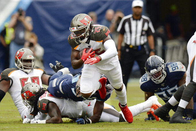 Tampa Bay Buccaneers running back Peyton Barber (25) carries the ball against the Tennessee Titans in the first half of an NFL football game Sunday, Oct. 27, 2019, in Nashville, Tenn. (AP Photo/Mark Zaleski)