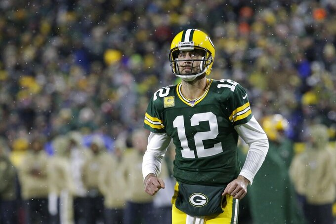 Green Bay Packers' Aaron Rodgers takes the field during the first half of an NFL football game against the Carolina Panthers Sunday, Nov. 10, 2019, in Green Bay, Wis. (AP Photo/Mike Roemer)