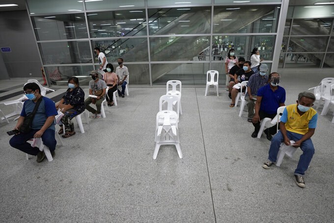Residents wait for a dose of the AstraZeneca COVID-19 vaccine at the Central Vaccination Center in Bangkok, Thailand, Thursday, July 22, 2021. (AP Photo/Sakchai Lalit)