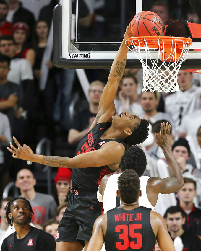 Houston center Brison Gresham (55) scores in the second half in the first half of an NCAA college basketball game, Saturday, Feb. 1, 2020, in Cincinnati. (Kareem Elgazzar/The Cincinnati Enquirer via AP)