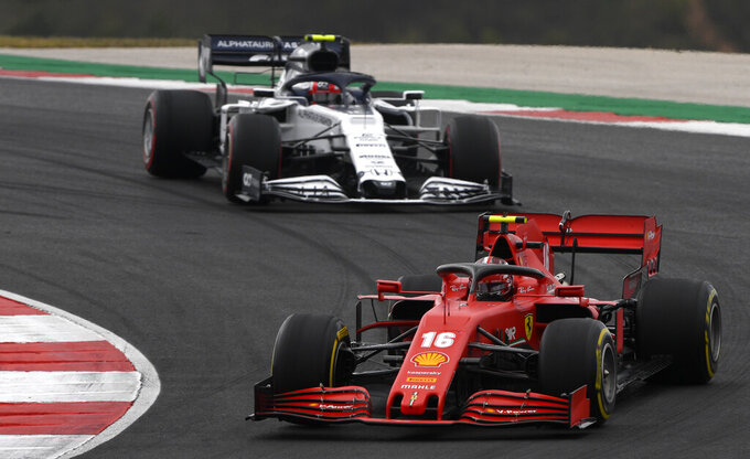 Ferrari driver Charles Leclerc of Monaco steers his car followed by AlphaTauri driver Pierre Gasly of France during the Formula One Portuguese Grand Prix at the Algarve International Circuit in Portimao, Portugal, Sunday, Oct. 25, 2020. (Rudy Carezzevoli, Pool via AP)