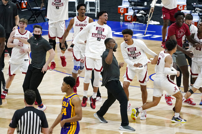 Alabama players celebrate after beating LSU in the championship game at the NCAA college basketball Southeastern Conference Tournament Sunday, March 14, 2021, in Nashville, Tenn. (AP Photo/Mark Humphrey)