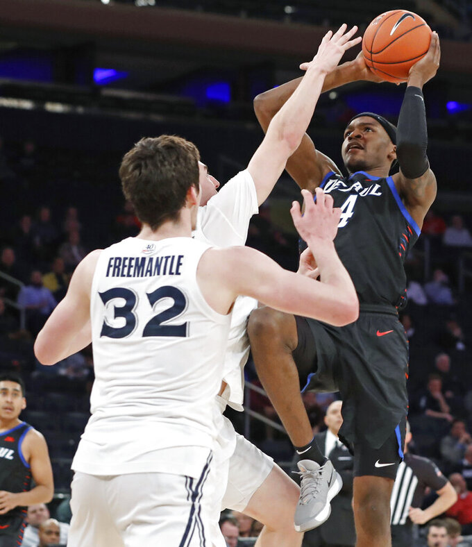 DePaul forward Paul Reed (4) shoots as two Xavier players, including Zach Freemantle (32), defend during the second half of an NCAA college basketball game in the first round of the Big East men's tournament Wednesday, March 11, 2020, in New York. DePaul won 71–67. (AP Photo/Kathy Willens)