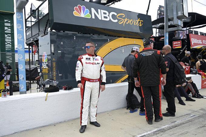 Driver Tim Viens stands on pit road before a NASCAR Xfinity Series auto race at Daytona International Speedway, Saturday, Aug. 28, 2021, in Daytona Beach, Fla. (AP Photo/Phelan M. Ebenhack)