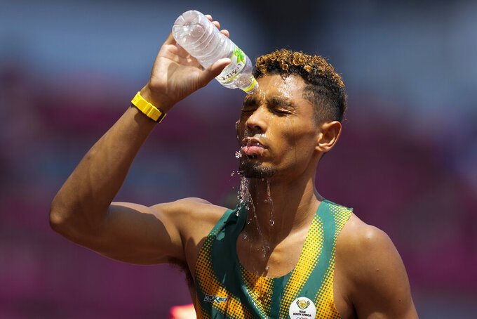 Wayde Van Niekerk, of South Africa, cools off after a heat in the men's 400-meter run at the 2020 Summer Olympics, Sunday, Aug. 1, 2021, in Tokyo. (AP Photo/Martin Meissner)