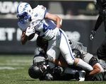 Air Force running back Kadin Remsberg, front, is dragged down after a short gain by Colorado cornerback Delrick Abrams Jr., back left, and defensive end Mustafa Johnson in the second half of an NCAA college football game Saturday, Sept. 14, 2019, in Boulder, Colo. Air Force won 30-23 in overtime. (AP Photo/David Zalubowski)