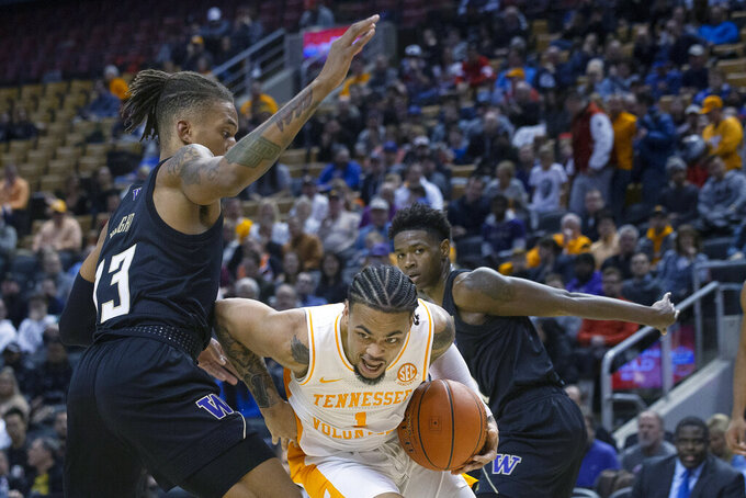 Bowden scores 18 as Tennessee upsets No. 20 Washington 75-62