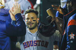 Houston Astros' Jose Altuve celebrates in the dugout after scoring on a single by Michael Brantley during the third inning of Game 3 of the baseball World Series against the Washington Nationals Friday, Oct. 25, 2019, in Washington. (AP Photo/Patrick Semansky)