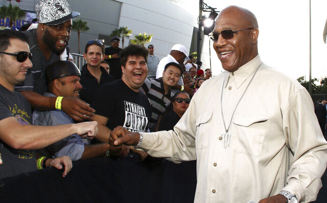 FILE - In this Monday, Aug. 10, 2015 file photo, Tommy 'Tiny' Lister greets fans as he arrives at the Los Angeles premiere of
