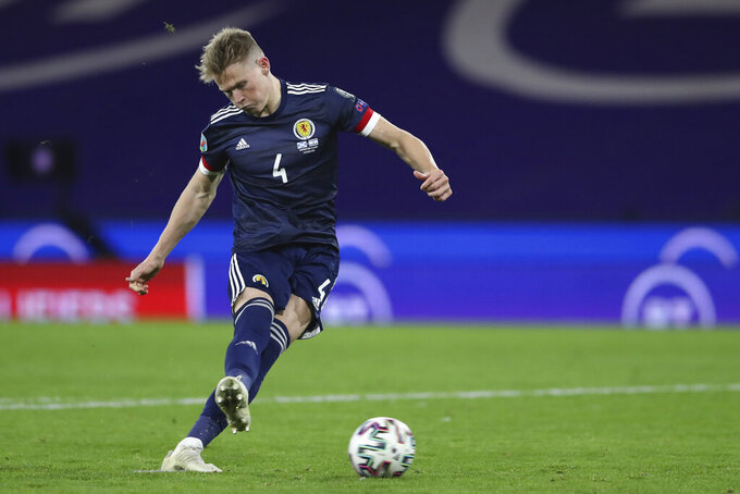 FILE - In this Thursday, Oct. 8, 2020 filer, Scotland's Scott McTominay shoots a penalty shot during the Euro 2020 playoff semifinal soccer match between Scotland and Israel, at the Hampden stadium in Glasgow, Scotland. (AP Photo/Scott Heppell, File)