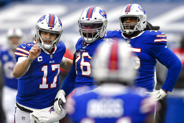 Buffalo Bills quarterback Josh Allen (17) reacts after throwing a touchdown pass in the first half of an NFL football game against the Miami Dolphins, Sunday, Jan. 3, 2021, in Orchard Park, N.Y. (AP Photo/Adrian Kraus)