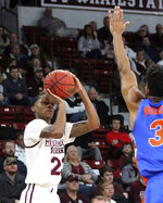 Mississippi State guard Tyson Carter (23) shoots over the outstretched arm of Florida guard Jalen Hudson (3) during the first half of an NCAA college basketball game Tuesday, Jan. 15, 2019, in Starkville, Miss. (AP Photo/Jim Lytle)