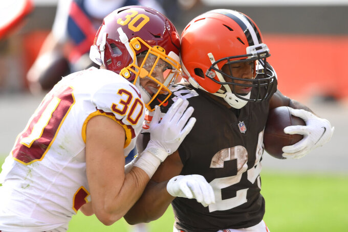 Cleveland Browns running back Nick Chubb (24) rushes for a 20-yard touchdown as Washington Football Team free safety Troy Apke (30) defends during the second half of an NFL football game, Sunday, Sept. 27, 2020, in Cleveland. The Browns won 34-20. (AP Photo/David Richard)