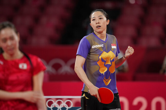 Singapore's Yu Mengyu competes during the table tennis women's singles quarterfinal match against Japan's Kasumi Ishikawa at the 2020 Summer Olympics, Wednesday, July 28, 2021, in Tokyo. (AP Photo/Kin Cheung)