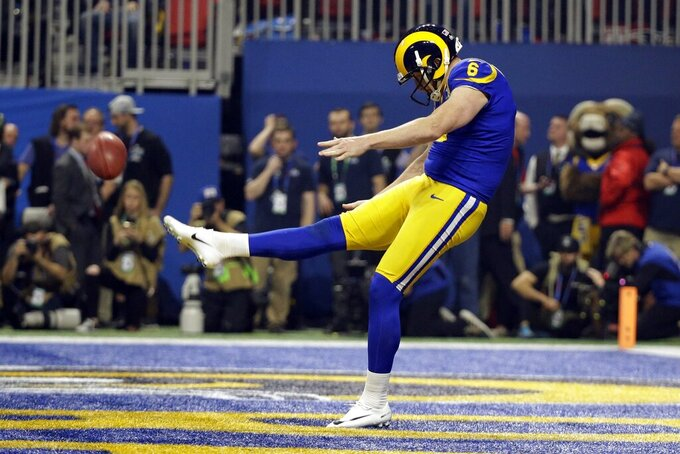 Los Angeles Rams' Johnny Hekker (6) makes a 65-yard punt during the second half of the NFL Super Bowl 53 football game against the New England Patriots, Sunday, Feb. 3, 2019, in Atlanta. (AP Photo/Mark Humphrey)