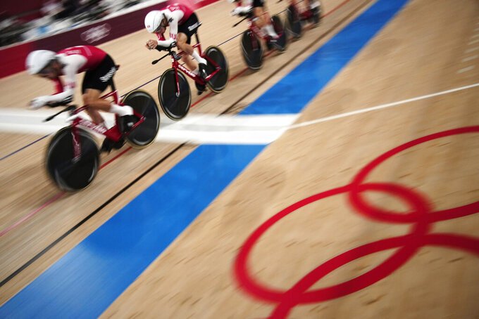 Italy rallies past Denmark for dramatic team pursuit gold