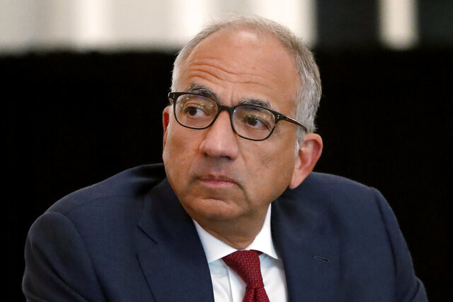FILE - In this Dec. 6, 2019, file photo, U.S. Soccer President Carlos Cordeiro presides over a meeting of the U.S. Soccer Board of Directors in Chicago. Cordeiro resigned Thursday night, March 12, 2020, three days after the organization filed legal papers in a gender discrimination claiming women players had less physical ability and responsibility than men. (AP Photo/Charles Rex Arbogast, File)
