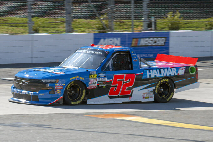 FILE - In this March 23, 2019, file photo, Stewart Friesen qualifies for the NASCAR Gander Outdoors Truck Series race at Martinsville Speedway in Martinsville, Va. The NASCAR Truck Series has its championship race Friday, Nov. 15, 2019, at Homestead-Miami Speedway. Brett Moffitt, Matt Crafton and Stewart Friesen join Ross Chastain in the championship field. Moffitt is the defending series champion and will try to become the first repeat winner since Crafton in 2013 and 2014. (AP Photo/Matt Bell, File)