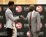 Atlanta Hawks first-round NBA draft pick Cam Reddish of Duke, left, speaks with head basketball coach Lloyd Pierce during a news conference Monday, June 24, 2019, in Atlanta. (AP Photo/John Bazemore)