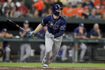 Tampa Bay Rays' Austin Meadows watches his solo home run off Baltimore Orioles starting pitcher Asher Wojciechowski during the third inning of a baseball game Thursday, Aug. 22, 2019, in Baltimore. (AP Photo/Julio Cortez)