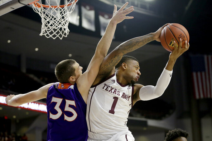 Texas A&M guard Savion Flagg (1) grabs a rebound away from Northwestern State forward Dalin Williams (35) during the first half of an NCAA college basketball game Wednesday, Nov. 6, 2019, in College Station, Texas. (AP Photo/Sam Craft)