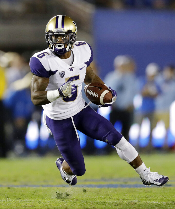 FILE - In this Oct. 6, 2018, file photo, Washington running back Myles Gaskin carries the ball against UCLA during the second half of an NCAA college football game in Pasadena, Calif. With two more victories — beginning Saturday against Oregon State — the Huskies would find themselves in the Pac-12 title game playing for a chance to go to Pasadena as the conference champion. (AP Photo/Marcio Jose Sanchez, File)