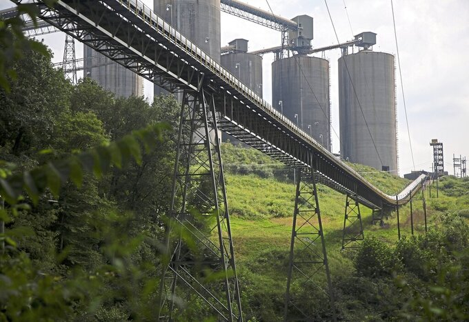 A long conveyor at Consol Energy's Bailey Mine sits silent and empty running through a dense tree line Thursday, Aug. 16, 2018 in Waynesburg, Pa. (Jessie Wardarski/Pittsburgh Post-Gazette via AP)