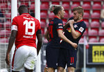 Leipzig's Timo Werner celebrates scoring their fourth goal with Kevin Kampl during a German Bundesliga soccer match between FSV Mainz 05 and RB Leipzig in Mainz, Germany, Sunday, May 24, 2020.  (Kai Pfaffenbach/pool via AP)