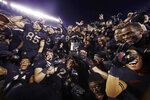 Army players celebrate with the Commander in Chief's trophy following a 17-10 victory over Navy in an NCAA college football game, Saturday, Dec. 8, 2018, in Philadelphia. Army won 17 -10. (AP Photo/Matt Rourke)