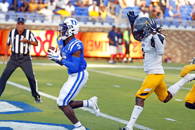 Duke's Jalon Calhoun (5) outruns North Carolina A&T's Miles Simon (4) to the end zone to score during the first half of an NCAA college football game in Durham, N.C., Saturday, Sept. 7, 2019. (AP Photo/Karl B DeBlaker)