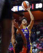 Los Angeles Sparks guard Nia Coffey shoots over Connecticut Sun center Brionna Jones during a WNBA basketball game Thursday, Aug. 26, 2021, in Uncasville, Conn. (Sean D. Elliot/The Day via AP)