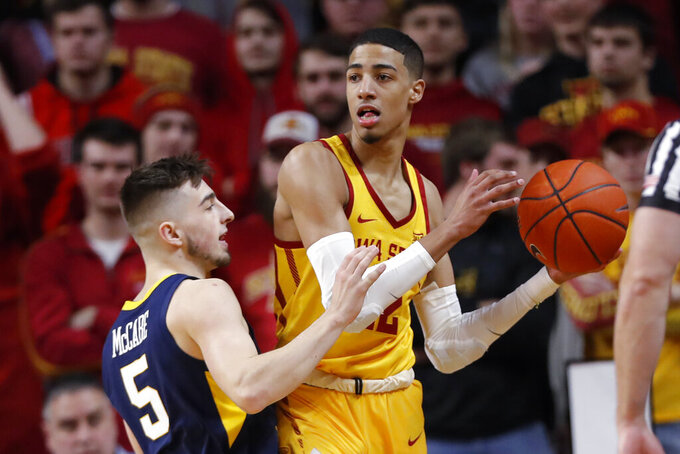 Iowa State guard Tyrese Haliburton is defended by West Virginia guard Jordan McCabe, left, during the first half of an NCAA college basketball game Wednesday, Jan. 30, 2019, in Ames, Iowa. (AP Photo/Charlie Neibergall)
