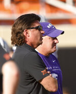 Oklahoma State head coach Mike Gundy, left, talks with Kansas State head coach Chris Klieman before an NCAA college football game in Stillwater, Okla., Saturday, Sept. 28, 2019. (AP Photo/Brody Schmidt)