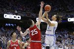 Ohio State guard D.J. Carton (3) and forward Kyle Young (25) defend while North Carolina guard Cole Anthony (2) shoots during the first half of an NCAA college basketball game in Chapel Hill, N.C., Wednesday, Dec. 4, 2019. (AP Photo/Gerry Broome)