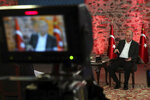 Turkey's President Recep Tayyip Erdogan speaks during a televised interviews in Istanbul, late Sunday, Jan. 5, 2020. Erdogan called for de-escalation between Iran and the U.S. following America's killing of Iranian Gen. Qassem Soleimani's in a drone strike in Baghdad, Iraq. Erdogan says the slaying of Soleimani will likely not go unanswered, and voiced concern about regional security risks.(Presidential Press Service via AP)