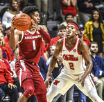 Arkansas guard Isaiah Joe (1) is defended by Mississippi guard Devontae Shuler (2) during an NCAA college basketball game Saturday, Jan. 11, 2020, in Oxford, Miss. (Bruce Newman/The Oxford Eagle via AP)