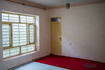 Light shines through an empty empty room of Ahmadullah's family house in Kabul, Afghanistan, Tuesday, Sept. 28, 2021. The family of seven sold their households as they are attempting to leave the country. (AP Photo/Bernat Armangue)