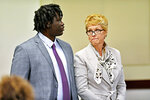 Emanuel Kidega Samson, 27, left, appears with his defense attorney, Jennifer Thompson, in court Monday, May 20, 2019, in Nashville, Tenn. Samson is accused of fatally shooting a woman and wounding seven people at a Nashville church in 2017. Prosecutors have said they're seeking life without parole for Samson. (George Walker IV/The Tennessean via AP, Pool)