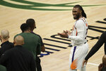 Phoenix Suns' Jae Crowder reacts as he talks with members of the Milwaukee Bucks bench during the second half of Game 3 of basketball's NBA Finals, Sunday, July 11, 2021, in Milwaukee. (AP Photo/Aaron Gash)