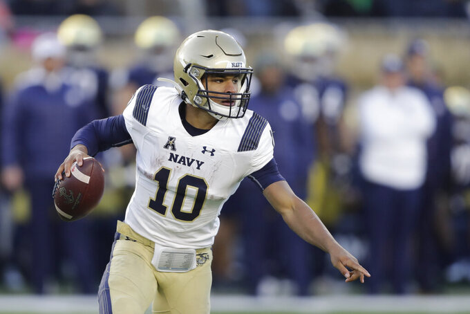 Navy quarterback Malcolm Perry (10) looks to throw during the second half of an NCAA college football game against Notre Dame, Saturday, Nov. 16, 2019, in South Bend, Ind. Notre Dame won 52-20. (AP Photo/Darron Cummings)