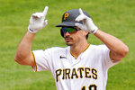 Pittsburgh Pirates' Bryan Reynolds celebrates as he crosses home plate after hitting a solo home run off Chicago Cubs starting pitcher Alec Mills during the second inning of a baseball game in Pittsburgh, Thursday, Sept. 24, 2020. (AP Photo/Gene J. Puskar)