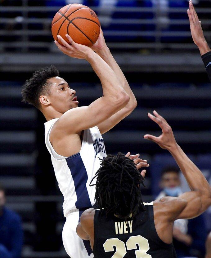 Penn State's Myreon Jones shoots for a basket over Purdue defenders during an NCAA college basketball game Friday, Feb. 26, 2021, in State College, Pa. (Abby Drey/Centre Daily Times via AP)