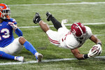 Alabama running back Najee Harris (22) leaps into the end zone for a touchdown against Florida during the first half of the Southeastern Conference championship NCAA college football game, Saturday, Dec. 19, 2020, in Atlanta. (AP Photo/John Bazemore)