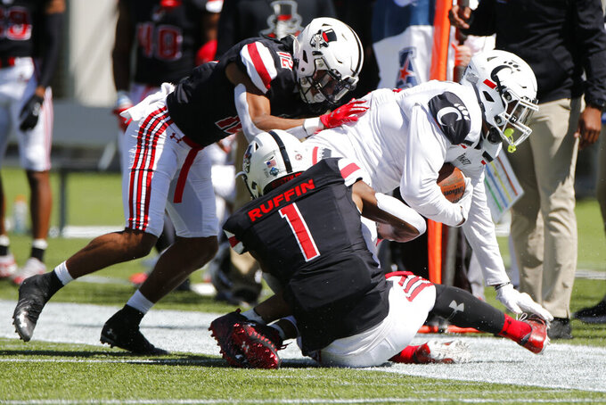 Cincinnati tight end Leonard Taylor, right, is tackled by Austin Peay defenders Nathan Page, left, and Kam Ruffin during the first half of an NCAA college football game Saturday, Sept. 19, 2020, in Cincinnati, Ohio. (AP Photo/Jay LaPrete)