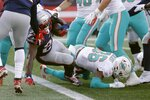 New England Patriots running back Sony Michel scores a touchdown against the Miami Dolphins in the first half of an NFL football game, Sunday, Dec. 29, 2019, in Foxborough, Mass. (AP Photo/Elise Amendola)