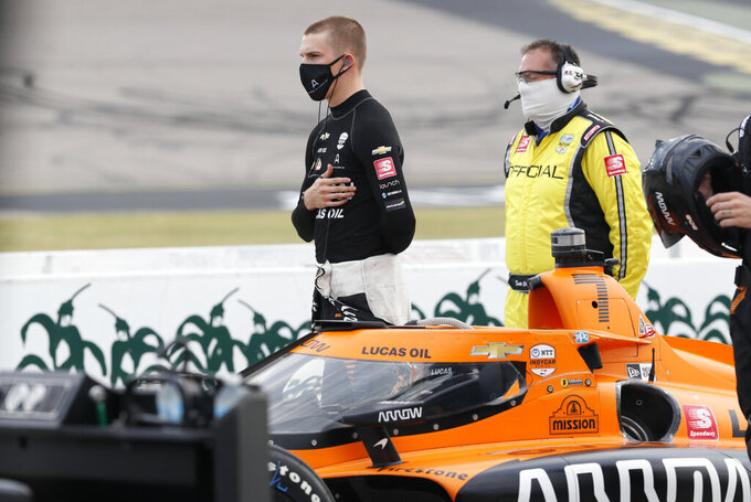 Oliver Askew stands next to his car during the national anthem before IndyCar Series auto race, Saturday, July 18, 2020, at Iowa Speedway in Newton, Iowa. (AP Photo/Charlie Neibergall)