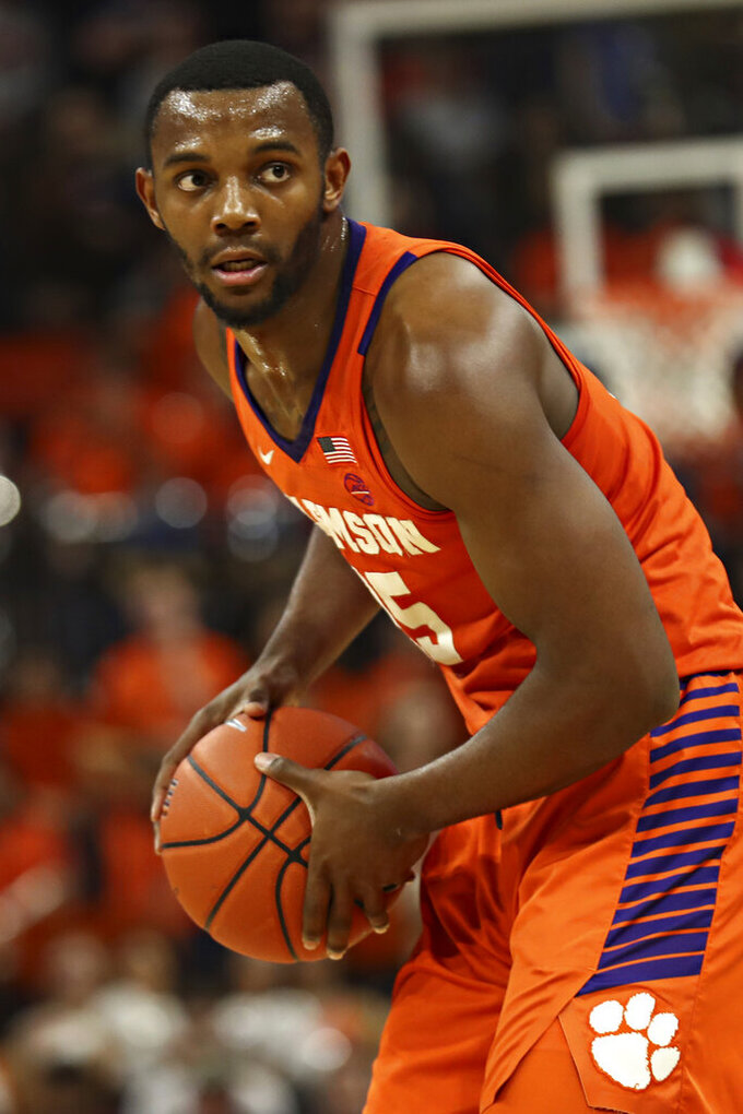 Clemson forward Aamir Simms (25) looks for an opening during the team's NCAA college basketball game against Virginia on Wednesday, Feb. 5, 2020, in Charlottesville, Va. (Erin Edgerton/The Daily Progress via AP)